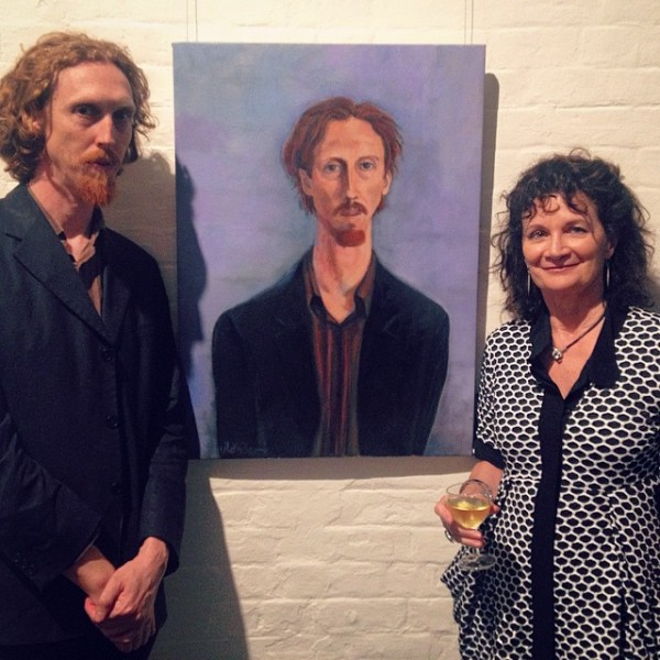 Trent Marden, lead singer of the band 'Holy Soul', with the portrait. Opening night, Portia Geach Award 2014